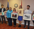 Congressional art contest contestants pictured are: Aramis Fernandez, Miami Springs Senior High School' Shawn Burbano, Miami Senior High School;  Andrea Ordonez, Miami Killian Senior High School; Kelly Mayol, Miami Springs Senior High School; Lea Broudo, Ransom Everglades High School; Anthony Ara,  Miami Senior High School and Linda Walters, Miami Senior High School.